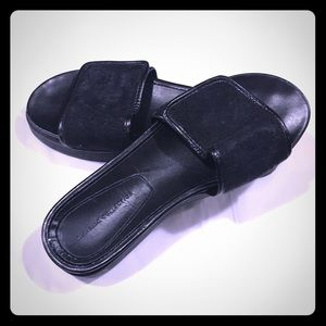 Zara black leather and horsehair platform slides.